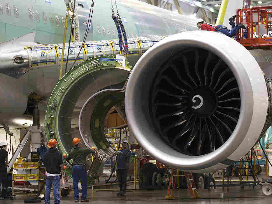 Boeing employees work on a plane engine at the company's factory in Everett, Wash. The Obama administration's corporate tax cut proposal would offer even deeper cuts for U.S. manufacturers like Boeing.