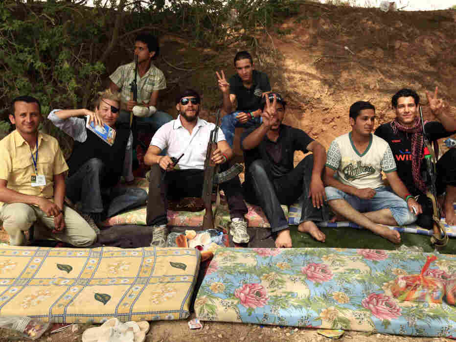 Journalist Marie Colvin (second from left) poses with Libyan rebels in Misrata on June 4, 2011. She was killed in the besieged Syrian city of Homs on Wednesday. Later that day in Tripoli, fellow war correspondents gathered to remember her.