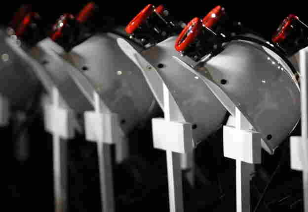 At an April 25, 2010, service in Beckley, W. Va., for the 29 miners killed in the Upper Big Branch explosion, helmets — placed on crosses — were lined up in their honor.
