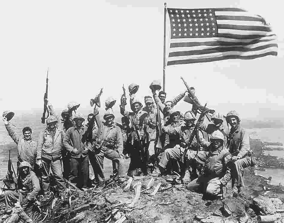 U.S. Marines cheer after raising the American flag on Iwo Jima.