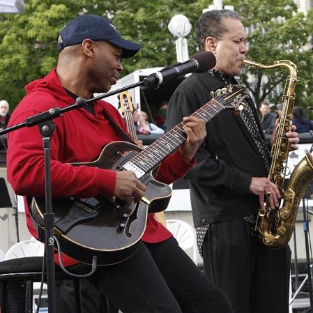 From left to right: Kevin Eubanks, Bill Pierce and Marvin Smitty Smith perform at the Detroit Jazz Festival.