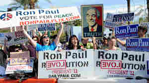 Fans of GOP presidential candidate Ron Paul show their support outside the Mesa Arts Center before Wednesday night's Republican debate in Mesa, Ariz.