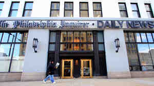 The publisher of the Philadelphia Inquirer and the Philadelphia Daily News has been accused of interfering with coverage of the newspapers' pending sale.