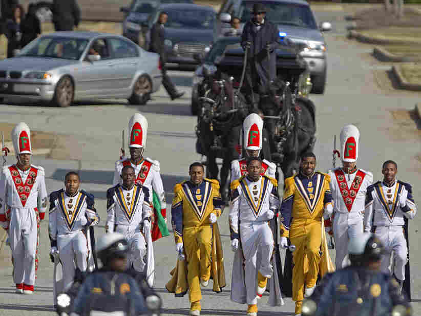 A marching band leads the horse-drawn carriage carrying Robert Champion following his November 2011 funeral in Decatur, Georgia.