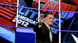 Former Massachusetts Gov. Mitt Romney waves to the crowd as he is introduced at the start of Wednesday night's Republican presidential debate in Mesa, Ariz.