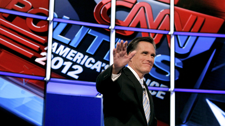 Former Massachusetts Gov. Mitt Romney waves to the crowd as he is introduced at the start of Wednesday night's Republican presidential debate in Mesa, Ariz. (Ross D. Franklin/AP)