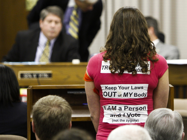 An abortion rights activist speaks before the Virginia Senate Education and Health Committee on Thursday. Following a protest outside the state capitol and criticism from moderates in his own party, Republican Gov. Bob McDonnell asked for revisions to a bill requiring an invasive ultrasound before an abortion.
