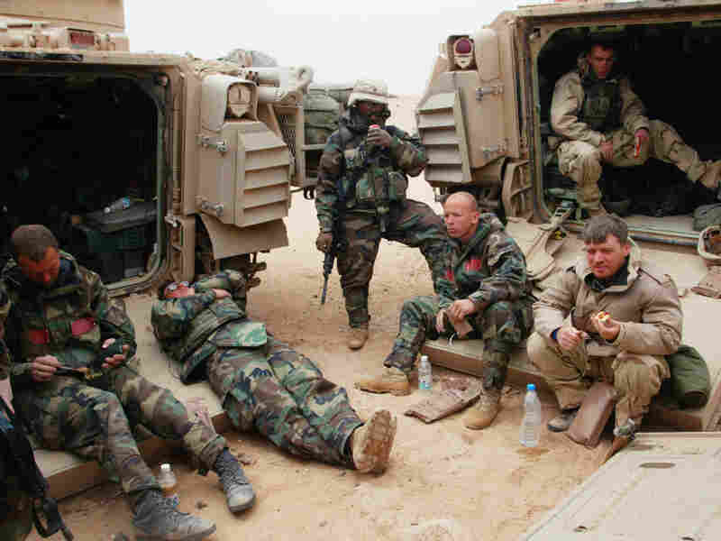 War correspondents traditionally covered conflicts by traveling with armies. Here, Associated Press reporter Chris Tomlinson, (right) is shown with U.S. forces in Iraq in 2003. But in many modern wars, reporters operate independently on the rebel side of the fighting, which raises the risks.