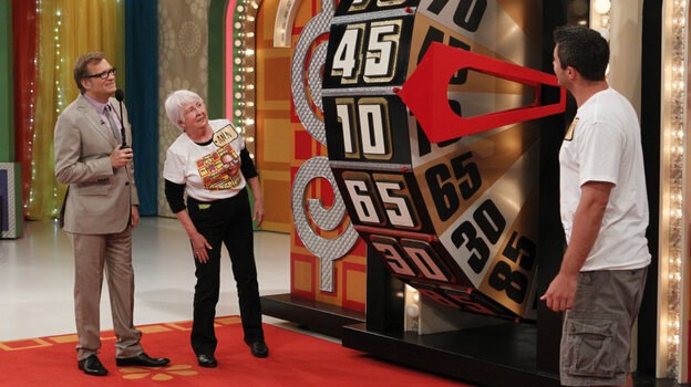 Drew Carey watches contestant Ann Bowman spin the big wheel on CBS's The Price Is Right.
