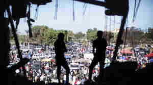 Libyans attend the Friday market the gardens inside the Bab al-Azizia compound in Tripoli, on Oct. 28, 2011.