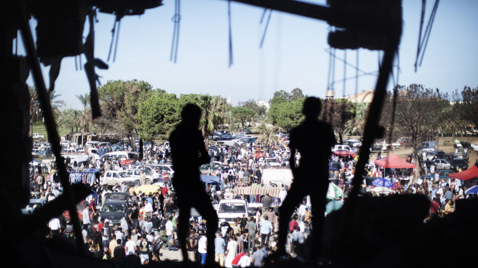 Libyans attend the Friday market the gardens inside the Bab al-Azizia compound in Tripoli, on Oct. 28, 2011.  (AFP/Getty Images)