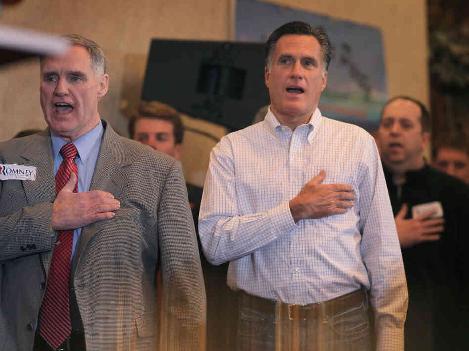 Mitt Romney sings the national anthem before speaking at a Tea Party event at the Bakers of Milford Banquet Hall on Thursday in Milford, M