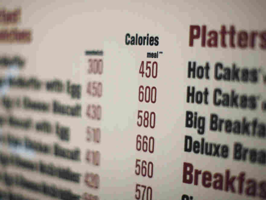 Calorie counts like the one on this McDonald's drive-thru in New York are intended to help people make healthier choices. But researchers say they're often too confusing.