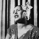 American blues singer Billie Holiday singing with an orchid in her hair.