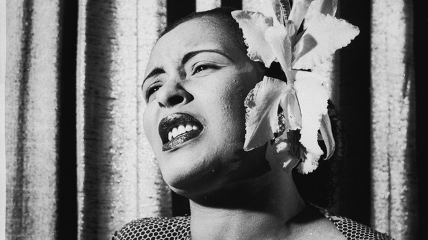American blues singer Billie Holiday singing with an orchid in her hair. (Getty Images)