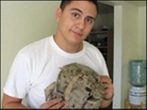 Marine Sgt. Oscar Canon, and the tattered hat he was wearing the day he was injured.