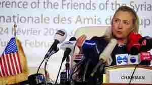 Secretary of State Hillary Clinton speaks during a press conference at a conference on Syria in Tunis, Tunisia, on Friday. The participants were united in their calls for a ceasefire and for Syrian President Bashar Assad to allow humanitarian aid into his country.