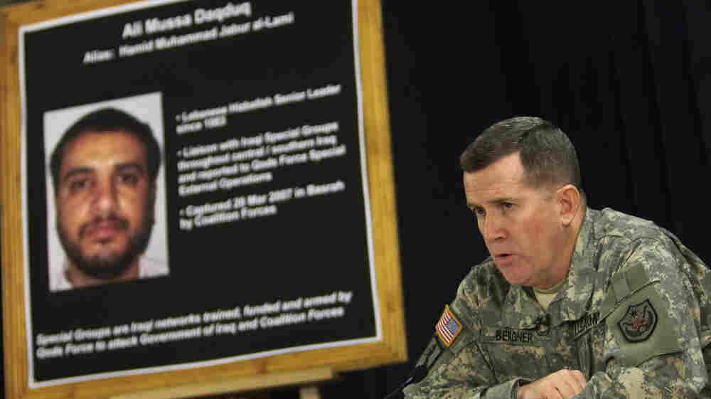 U.S. Brig. Gen. Kevin Bergner speaks in Baghdad in July 2007 near a poster of Ali Musa Daqduq. Daqduq was captured in Iraq in March 2007, and is accused of orchestrating the killings of five U.S. soldiers. The U.S. left Daqduq in Iraqi custody when U.S. troops formally withdrew in December. But the Obama administration is seeking to try him before a military commission.