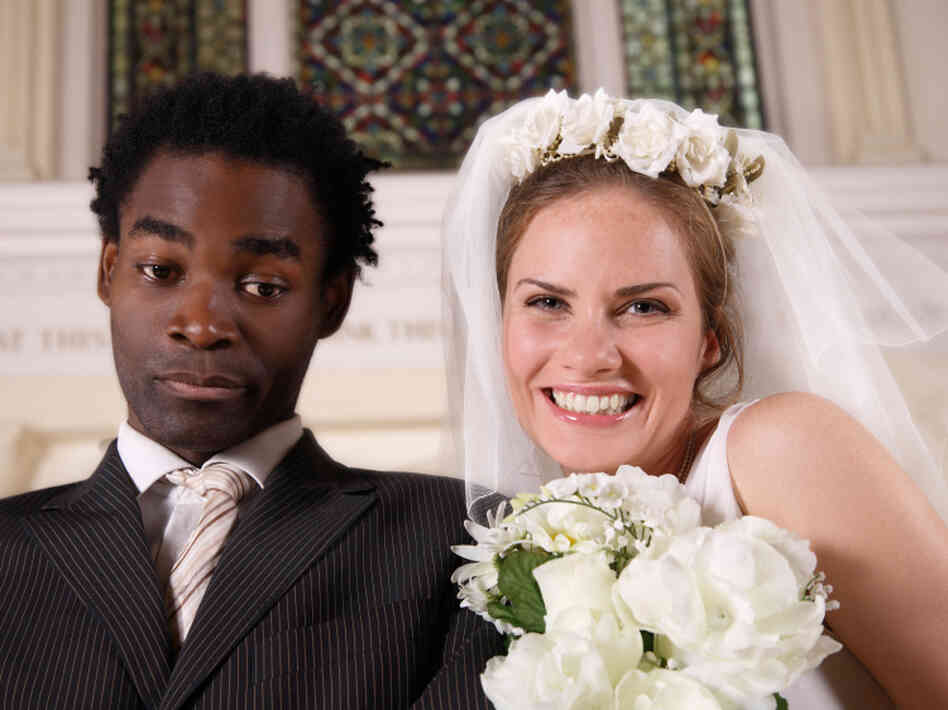 The bride is happy, but the groom not so much. A pew survey released last week found that the share of interracial and interethnic marriages has reached an all time high.
