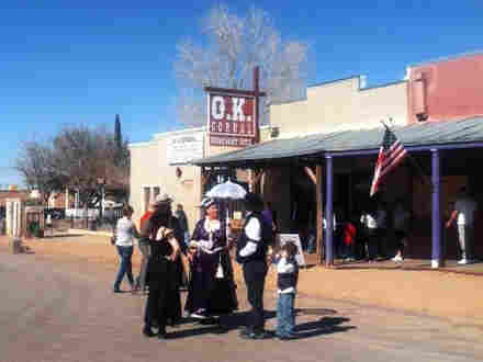 Tourists in Tombstone visit the O.K. Corral exhibits.