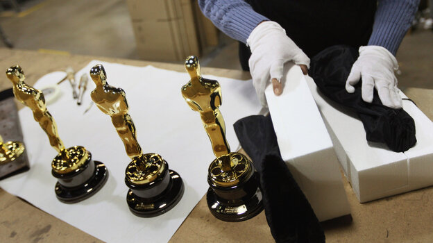 Josefina Govea packages an Oscar statuette at R.S. Owens & Company during a media demonstration February 9, 2012 in Chicago, Illinois.