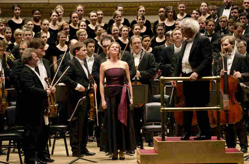 """Camilla Tilling and her fellow musicians acknowledge the audience's warm reception during the program's first half, in which Tilling sang the solo to Wolf's """"Elfenlied."""""""