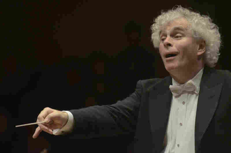 Simon Rattle at the podium — he conducted the nearly 90-minute symphony entirely from memory.