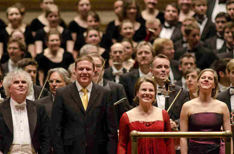 Westminster Symphonic Choir director Joe Miller joined Rattle, Fink and Tilling to receive the audience's loud cheers.