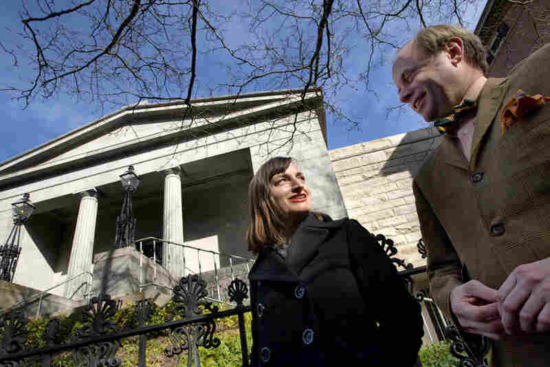 Christina Bevilacqua (left), director of programs and public engagement, and James Hall, executive director of the Providence Preservation Society, stand outside the Providence Athenaeum.