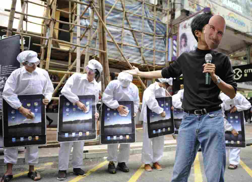 Protesters demonstrate against Foxconn, which manufactures Apple products in China, outside an Apple retail outlet in Hong Kong.