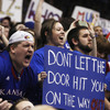 Kansas fans celebrate during the second half of an NCAA college basketball game against Missouri in Lawrence, Kan., on Saturday. Kansas defeated Missouri 87-86 in overtime.