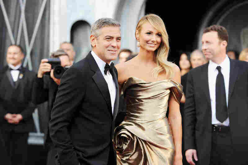George Clooney, nominated for Best Actor for his role in The Descendants, and his girlfriend, Stacy Kiebler, do the red carpet ritual at the Academy Awards.
