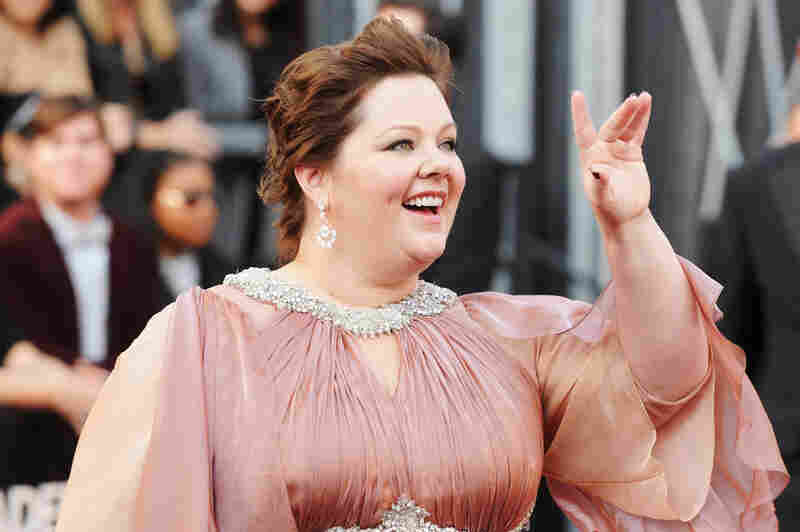Melissa McCarthy, up for Best Supporting Actress for her Role in Bridesmaids, waves to the crowd.
