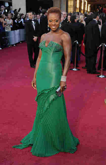 Viola Davis, nominated for Best Actress for her role in The Help, makes her way into the theater.