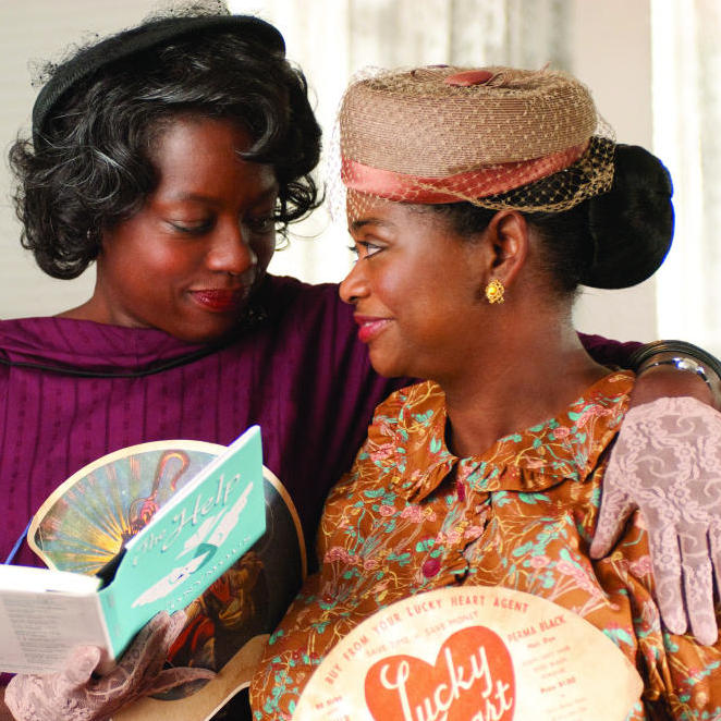 Best friends Aibileen Clark (Viola Davis, left) and Minny Jackson (Octavia Spencer) share a special moment in The Help.