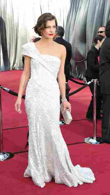 Milla Jovovich, scheduled to present at the ceremony, dazzled red-carpet watchers in an Elie Saab gown.