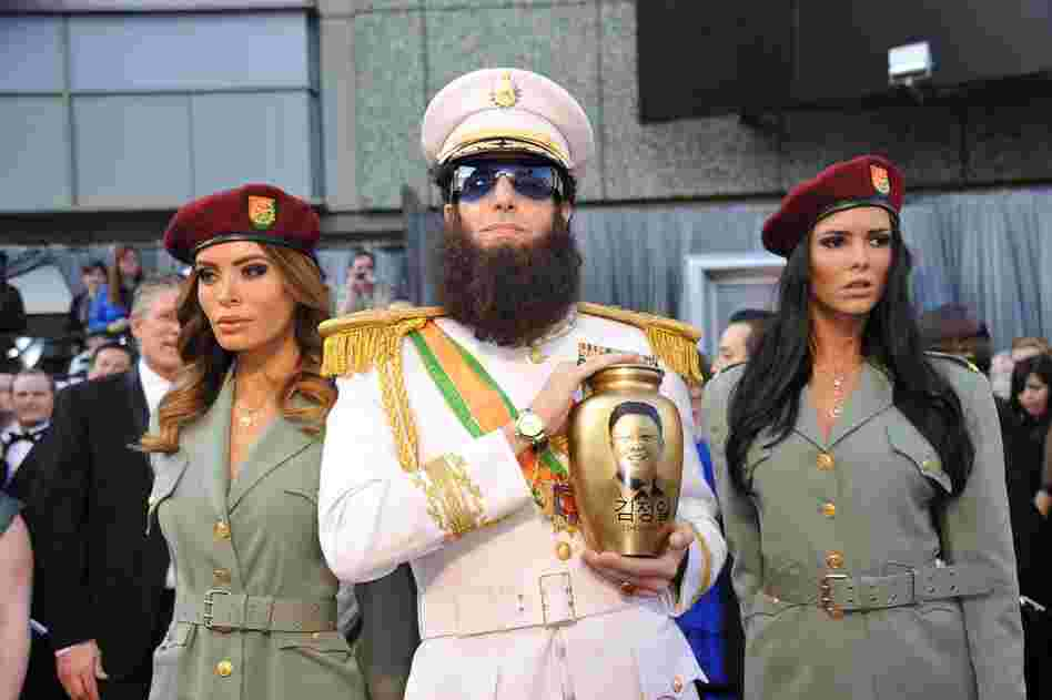 "Sacha Baron Cohen came dressed as his character in the upcoming film The Dictator — and spilled ""ashes"" from the urn on Ryan Seacrest during an interview on E!"