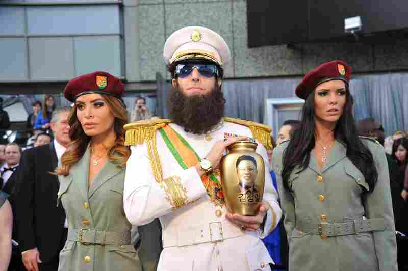 """Sacha Baron Cohen came dressed as his character in the upcoming film The Dictator — and spilled """"ashes"""" from the urn on Ryan Seacrest during an interview on E!"""