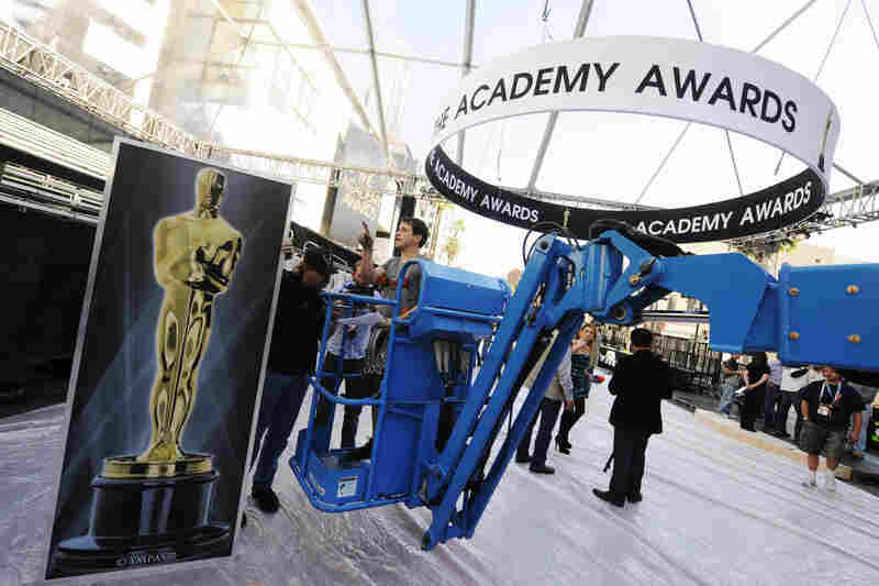 The Academy Awards banner hangs over where the red carpet will be placed at the entrance of the Kodak Theater.