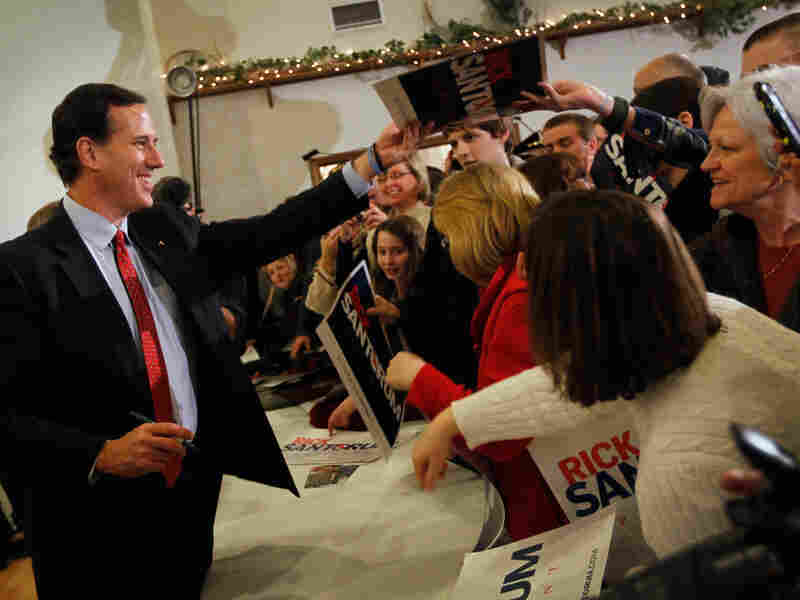 Republican presidential candidate Rick Santorum greets people during a campaign stop  on Feb. 26, 2012 in Davison, Michigan. Michigan residents will go to the polls on Feb. 28 to vote for their choice in the Republican presidential race.