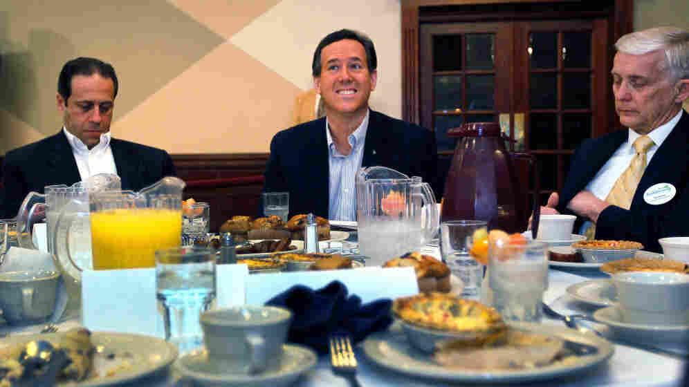 Rick Santorum (center) Monday at St. Mary's Cultural & Banquet Center in Livonia, Mich.