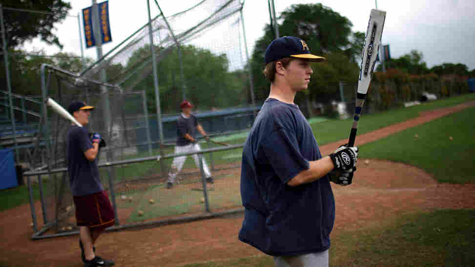 Members of the Arlington Heights High School baseball team swing their old-style aluminum bats during the 2009 season in Fort Worth, Texas. This year, high school players will use a different type of metal bat that's designed to reduce injuries.