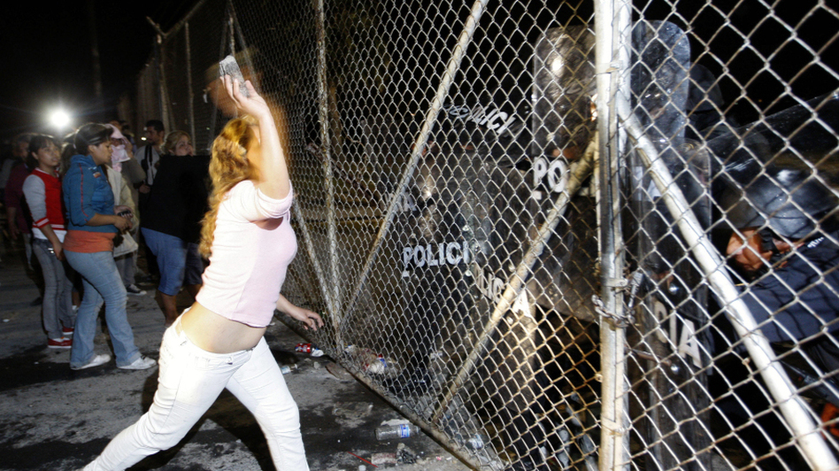 In northern Mexico, relatives of inmates at Apodaca prison outside Monterrey attack the security fence, Feb. 21. Violence at the prison on Feb. 19 left 48 inmates dead; the transfer of three prisoners to another criminal center prompted more violence two days later.  (AFP/Getty Images)