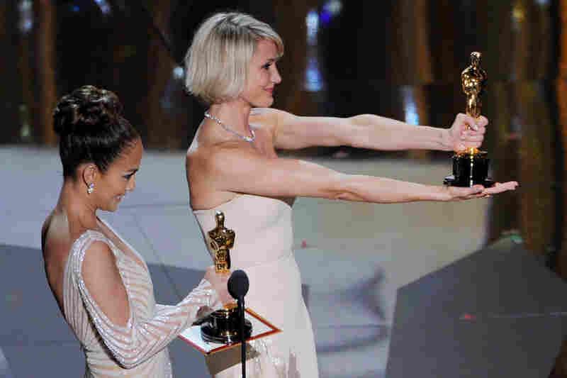 "Presenters Jennifer Lopez (left) and Cameron Diaz present the awards for Best Costume (Mark Bridges, ""The Artist"") and Best Makeup"