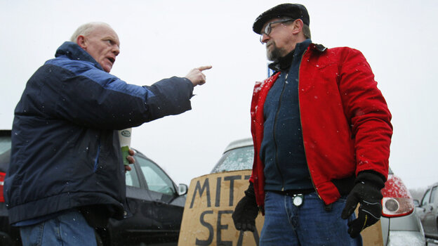 Chris McDonough, a Republican (left), and Robert O'Brien, a Democrat, argue about political issues outside a caucus in Portland, Maine, in February.