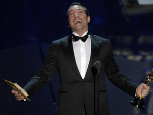 Jean Dujardin accepts the Oscar for best actor in a leading role for The Artist during the 84th Academy Awards on Sunday.