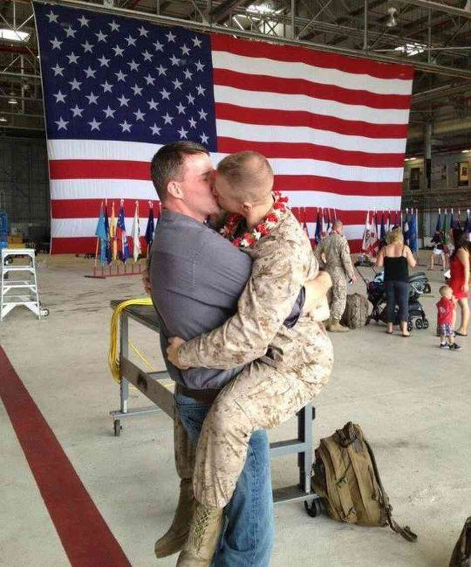 The kiss. That's Sgt. Brandon Morgan on the right. Dalan Wells on the left.
