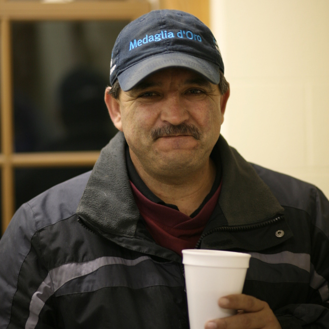 Eduardo Terrazas, with a cup of coffee brewed in the barn. It's the best, he says.