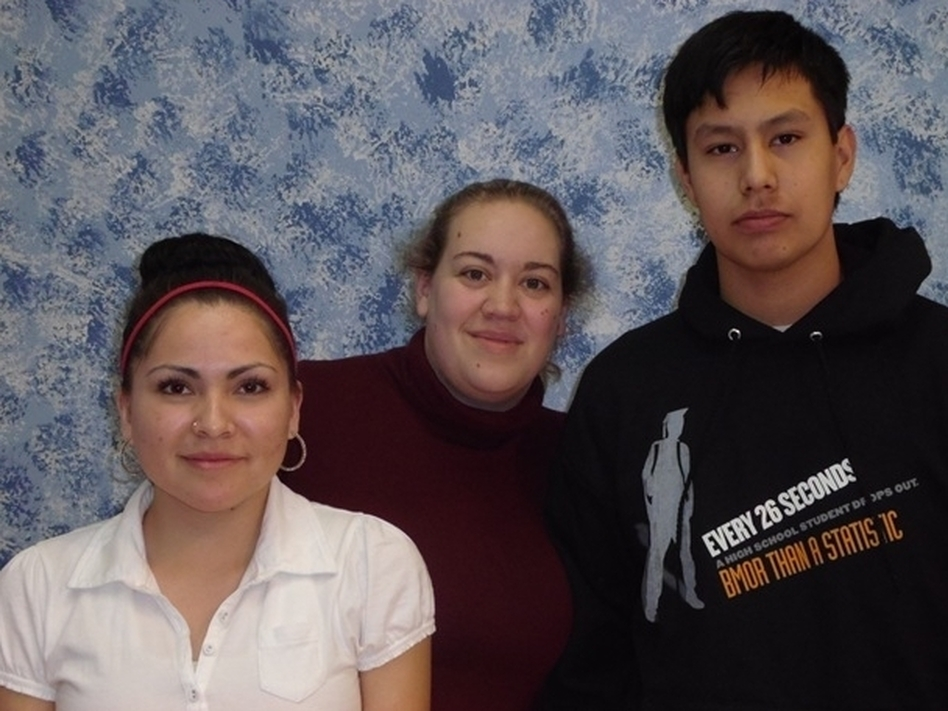 Feather Rae Colombe (from left) appeared in the Lakota student video <em>More Than That</em>. Kim Bos is a video technology teacher who helped produce the video. Student John Whirlwind Soldier directed the video.