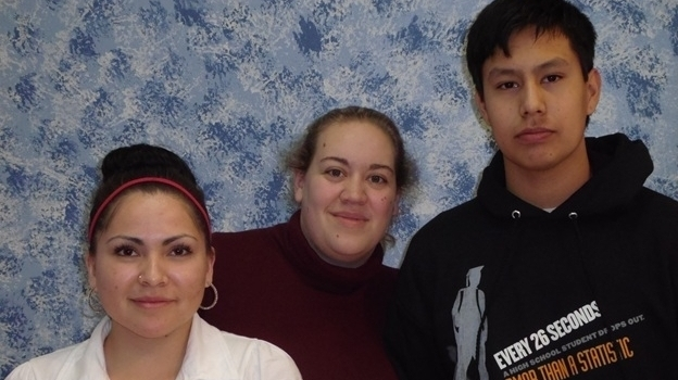 Feather Rae Colombe (from left) appeared in the Lakota student video More Than That. Kim Bos is a video technology teacher who helped produce the video. Student John Whirlwind Soldier directed the video. (Jim Kent)